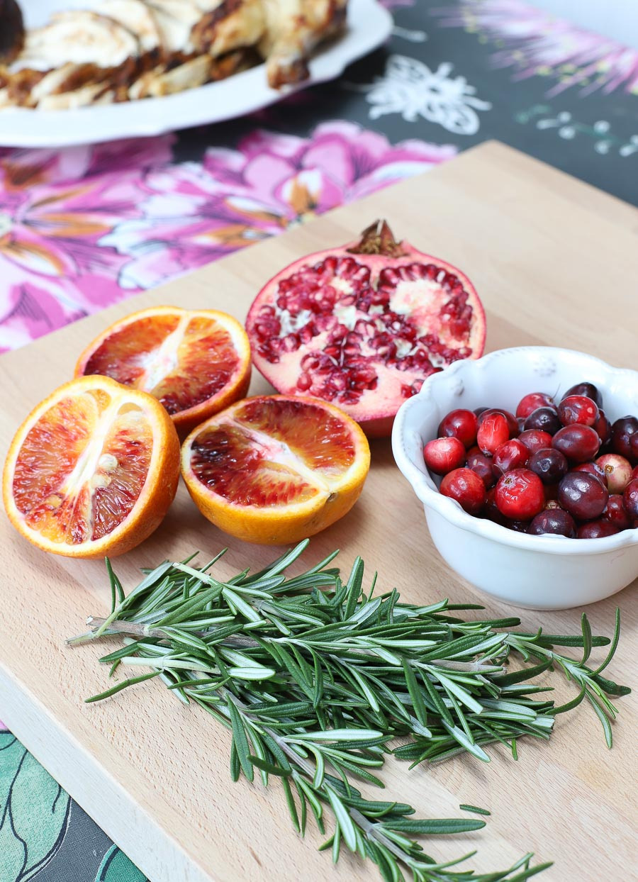 Pomegranates, blood oranges, cranberries, and fresh rosemary are used to dress up a rotisserie chicken. See more in the post!