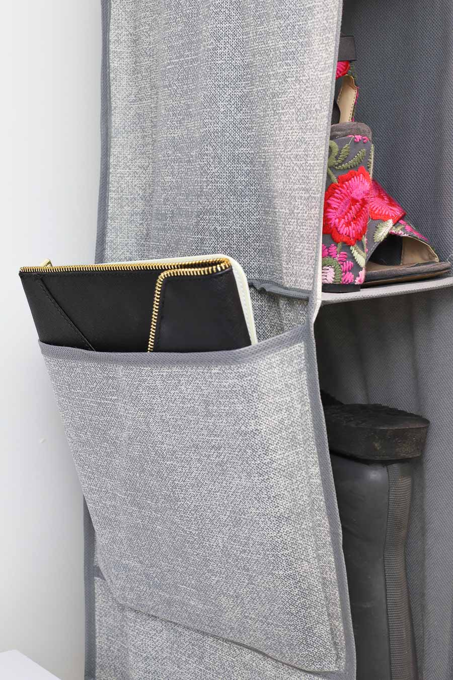 Storage pocket on the side of a hanging shoe and boot organizer - smart organization idea!