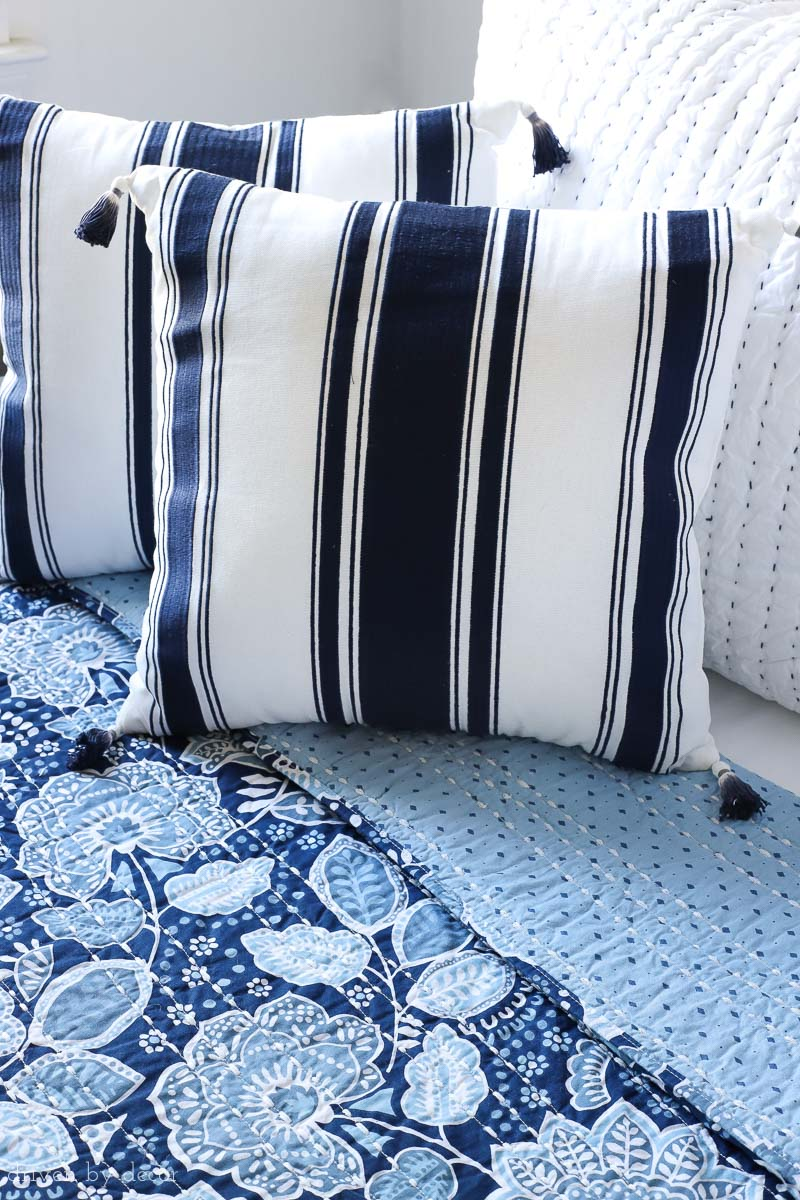 Loving the combination of the gorgeous blue and white Vera Bradley floral quilt and the navy stripe tasseled pillows!