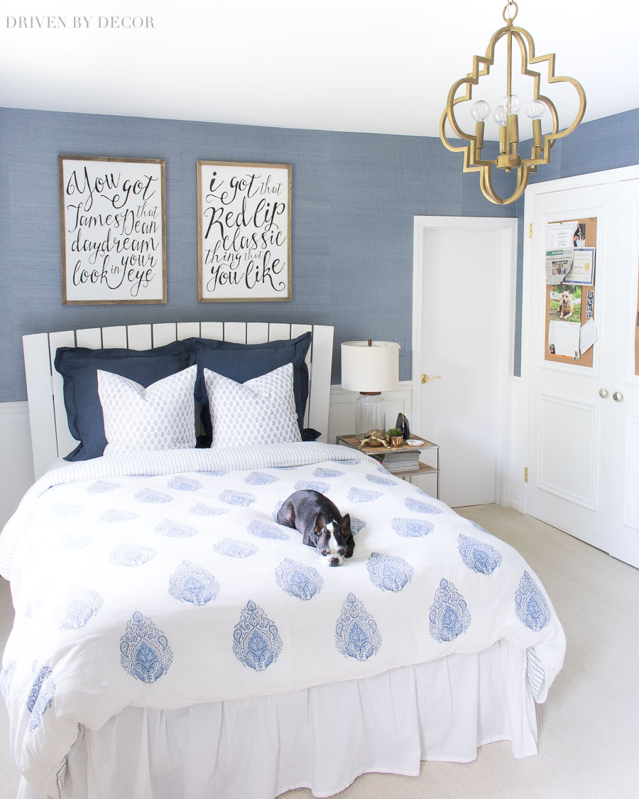 Love the blue and white color scheme for this bedroom with block print duvet, grasscloth wallpaper, Taylor Swift art prints, and gold quatrefoil pendant!