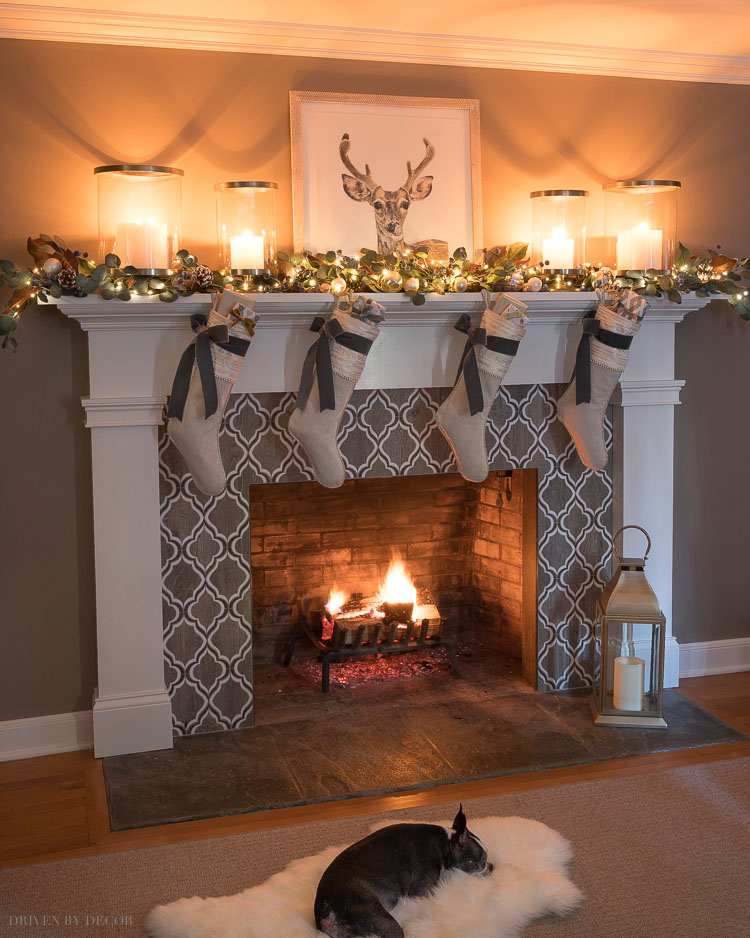 Gorgeous Christmas fireplace! Love the hurricanes!