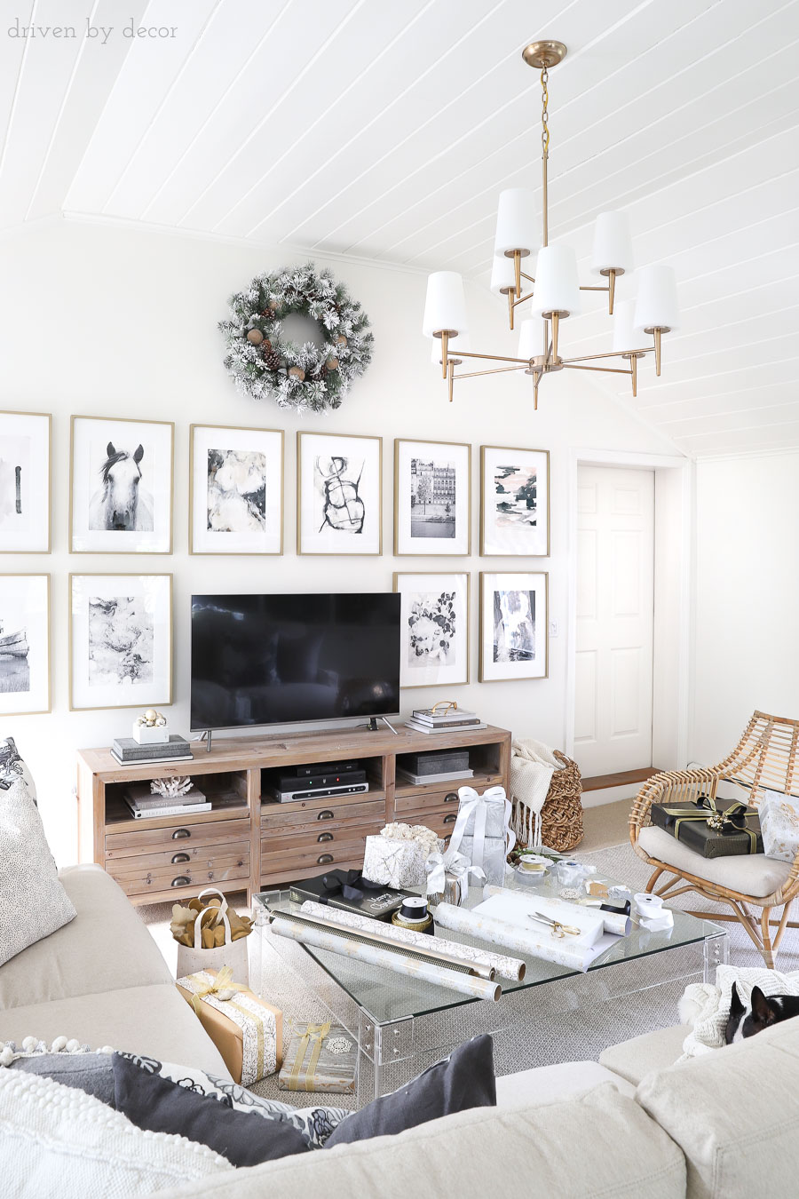 Family room decorated simply but beautifully for the holidays! LOVE that TV console and chandelier!!