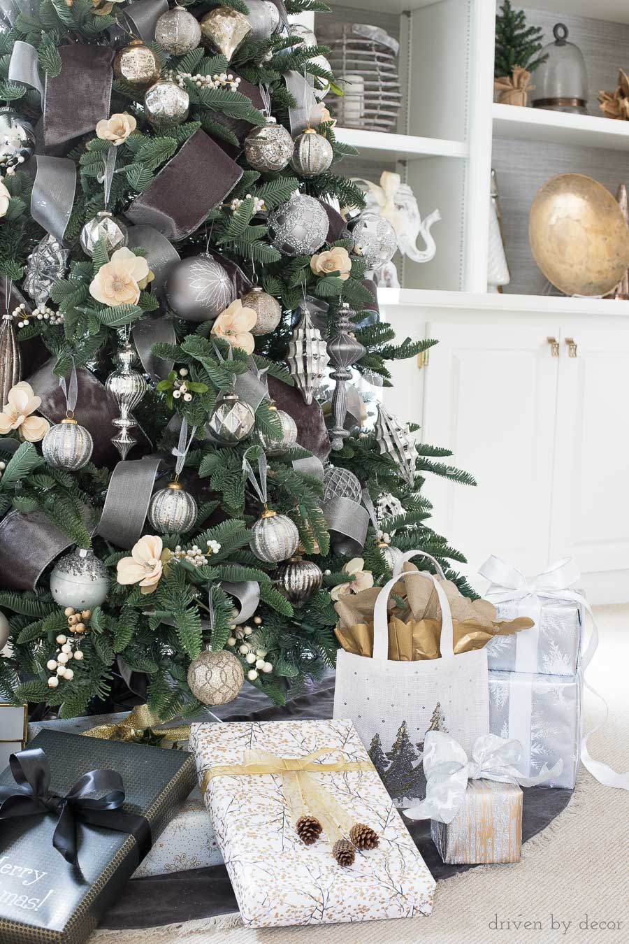 Beautiful Christmas tree with velvet ribbon and metallic ornaments along with gorgeously wrapped presents!