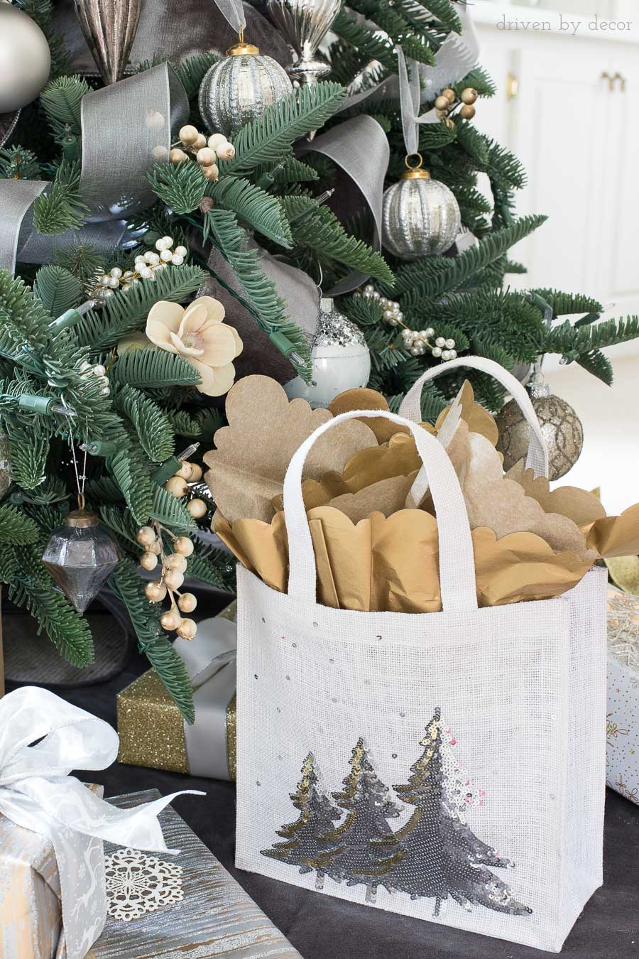 Adding tissue paper with a decorative edge to your gift bag takes it to the next level! Love all of the easy gift wrapping ideas in this post!