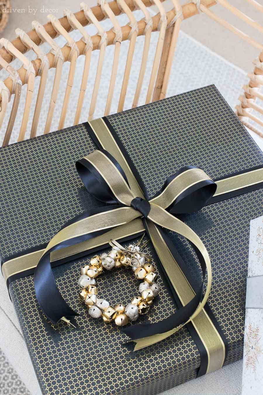 Love this idea of layering two ribbons to add a luxurious look to your gift! One of many easy gift wrapping ideas for Christmas presents in this post!