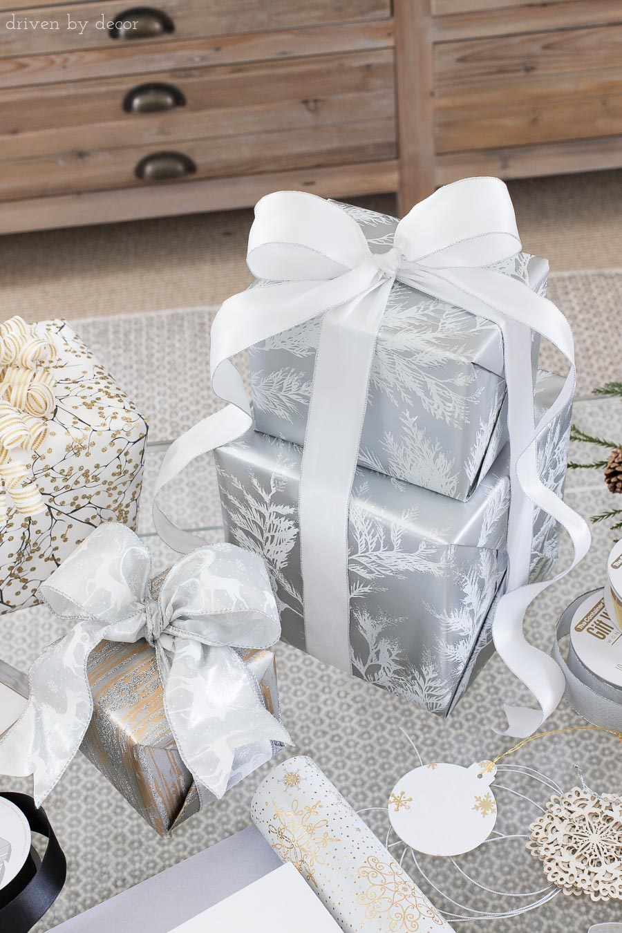 Stack two presents together and tie them with a cascading bow! One of the great easy gift wrapping ideas in this post!