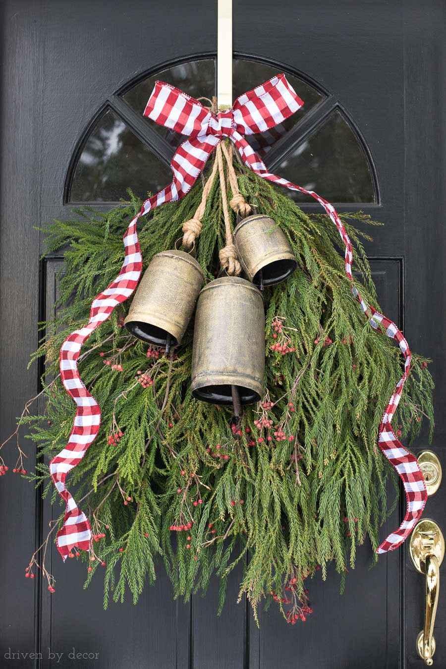 Our front door Christmas decoration - a greenery swag with bells and ribbon instead of a wreath!