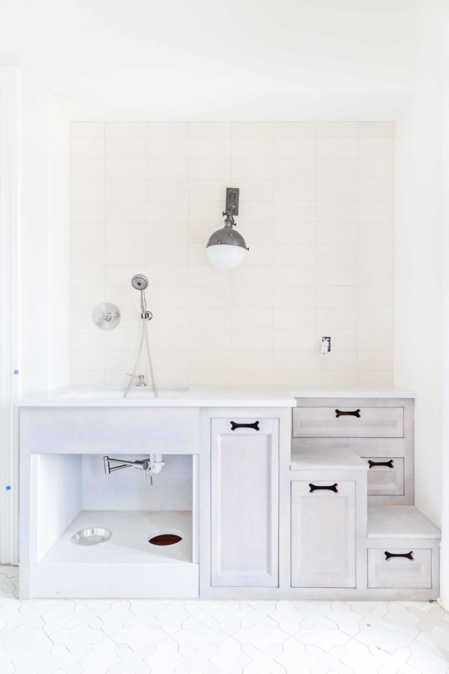 Amazing! Love this built-in dog wash sink and food bowls - design by Lori Paranjape