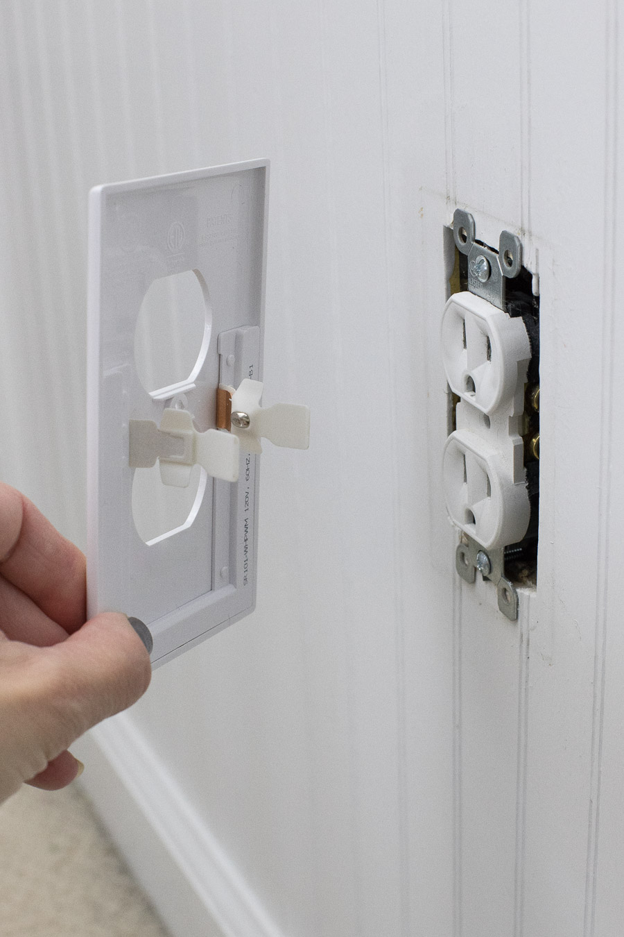 Have and LOVE this! A simple snap-in outlet cover that has a built in nightlight!
