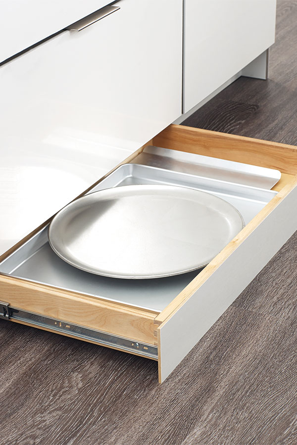 LOVE this toekick drawer - such a smart use of the bottom of your kitchen cabinets! Perfect for holding trays and cutting boards!