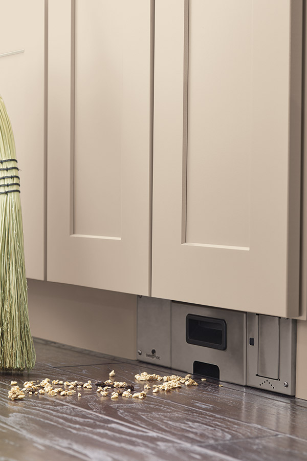 Toekick vacuum that turns on with the tap of your foot - sweep things right in! A must-have for my kitchen remodel!