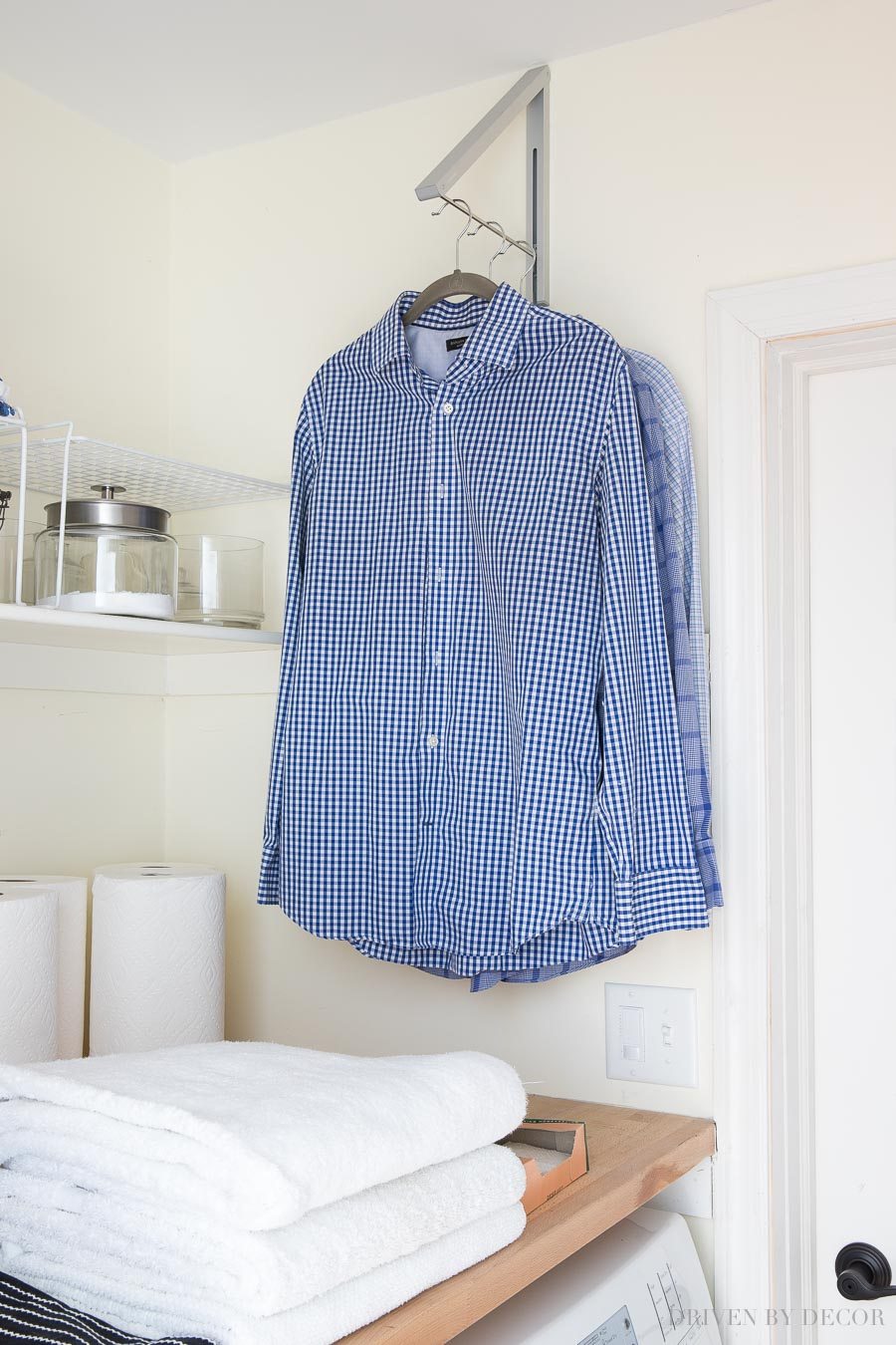 Such a lifesaver! Love this wall mounted folding clothes rack - perfect for air drying clothes or for hanging them immediately from the dryer to prevent wrinkles!
