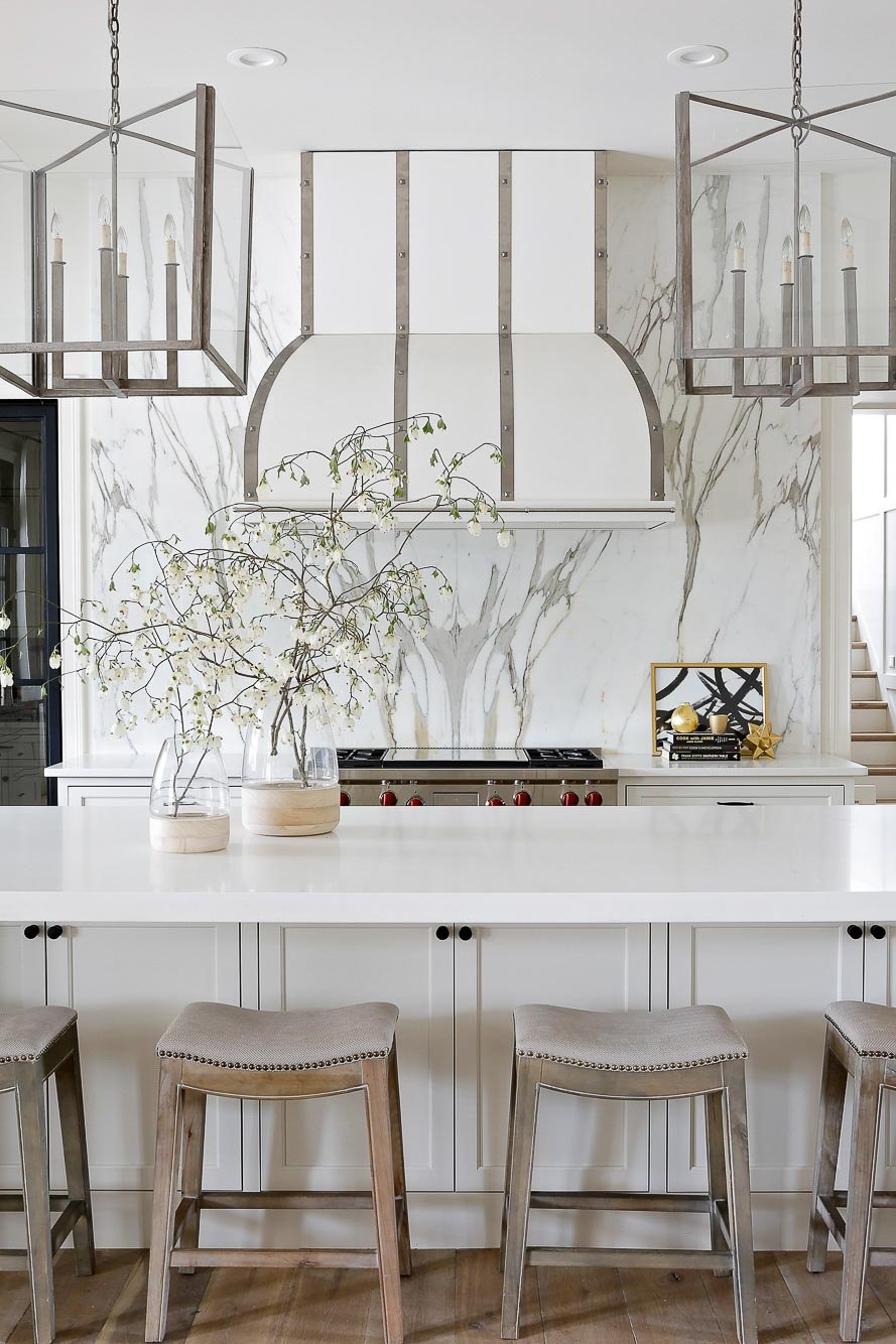 Gorgeous all white kitchen with silver / chrome accents designed by Lori Paranjape