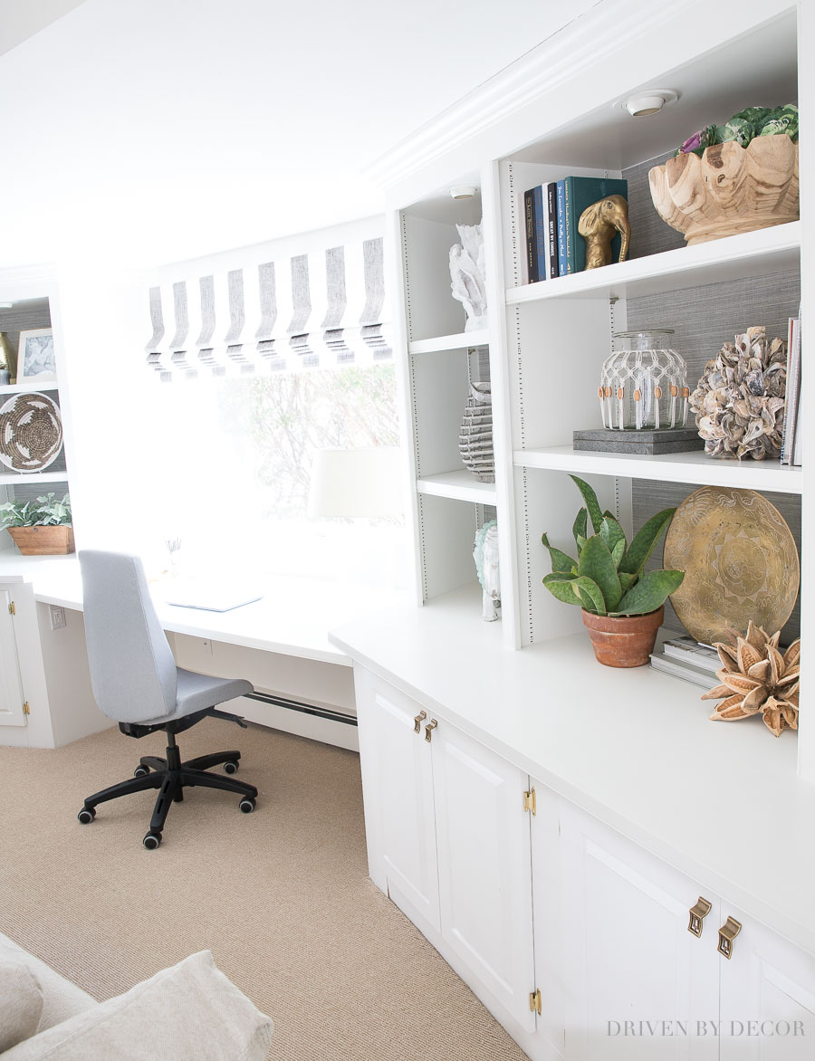 Built-in bookcases flanking desk and window in middle - a great arrangement for a family room!