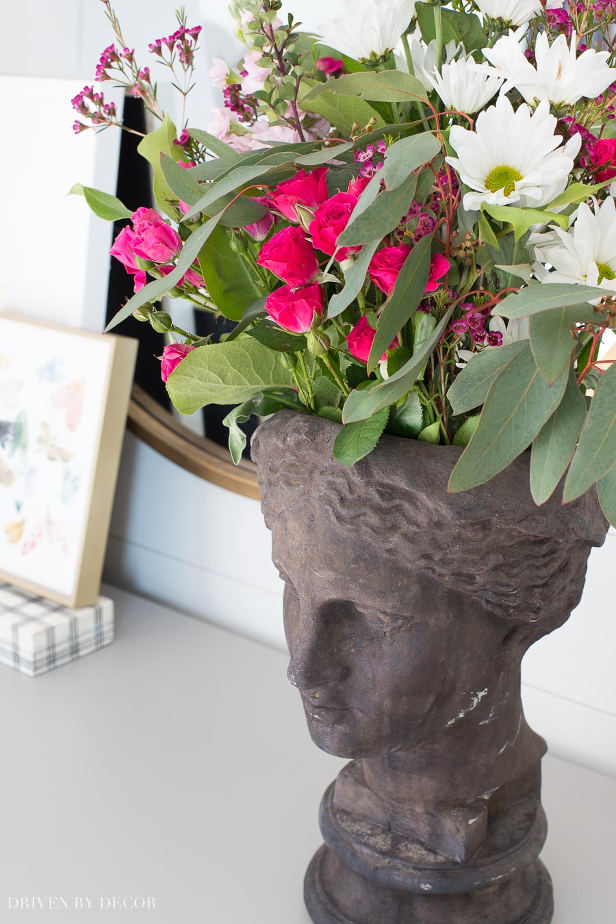 Girls head planter filled with flowers - love!