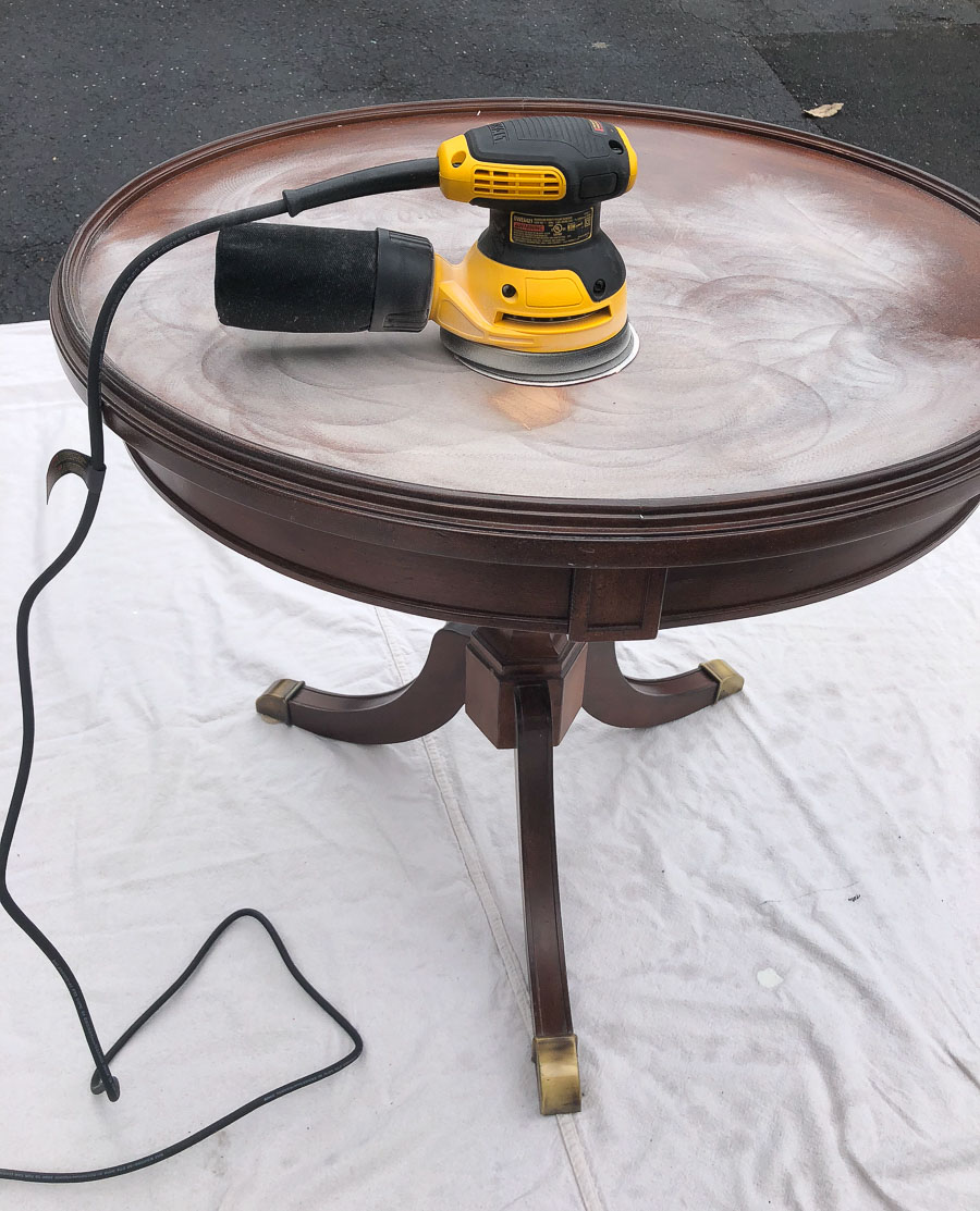 Removing old finish and scratches from a piece of furniture with an orbital sander