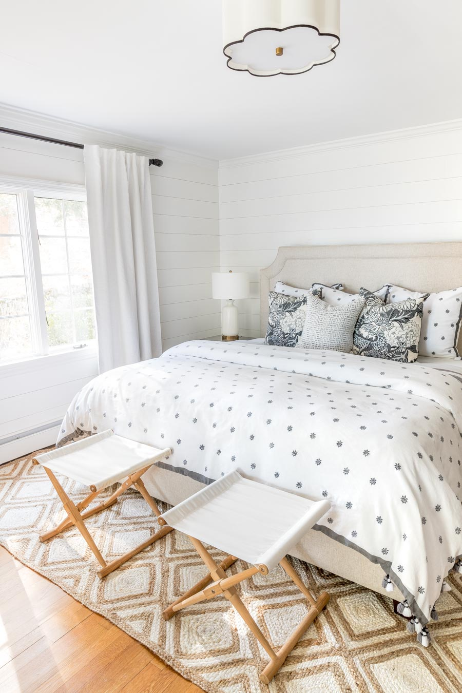 Love the shiplap walls in this bedroom - this post tells you how to do it!