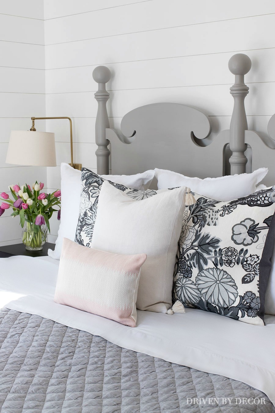 Pretty combination of pillows and bedding (love the quilt!) for spring!