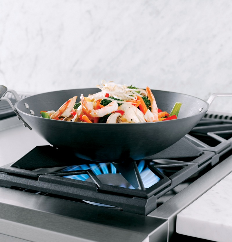This Monogram range has flat burners that reverse to contoured burners for cradling a wok - so smart!