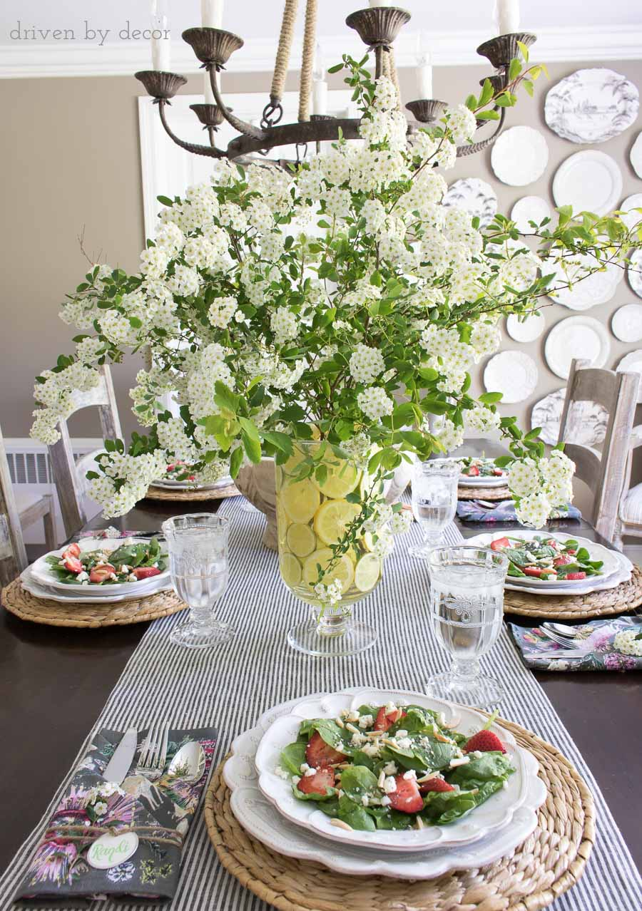 Slice lemons to line a vase for a beautiful, simple spring table centerpiece!