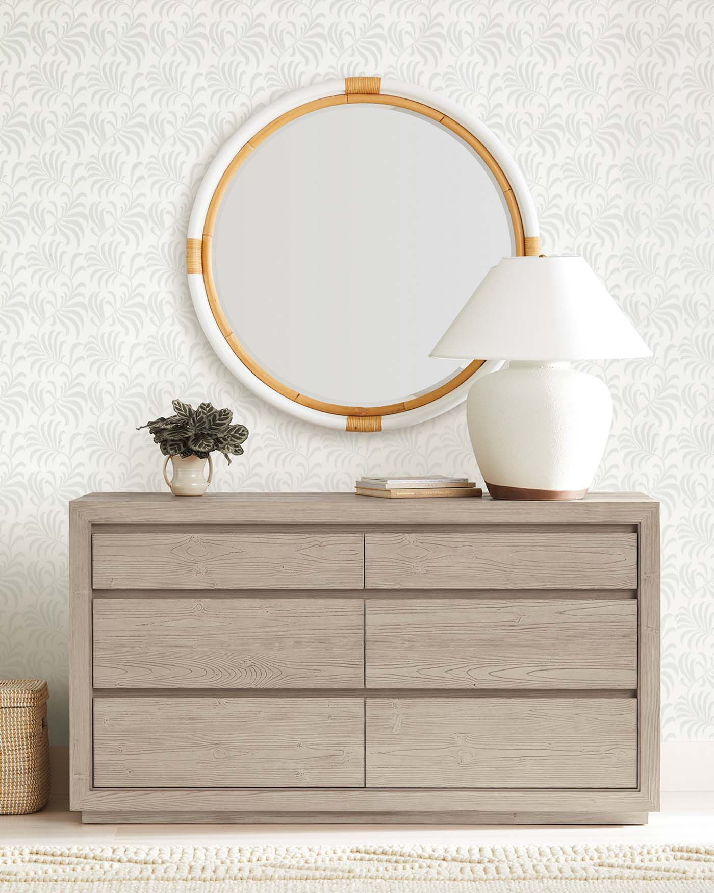 Love the look of the round rattan mirror over the dresser!