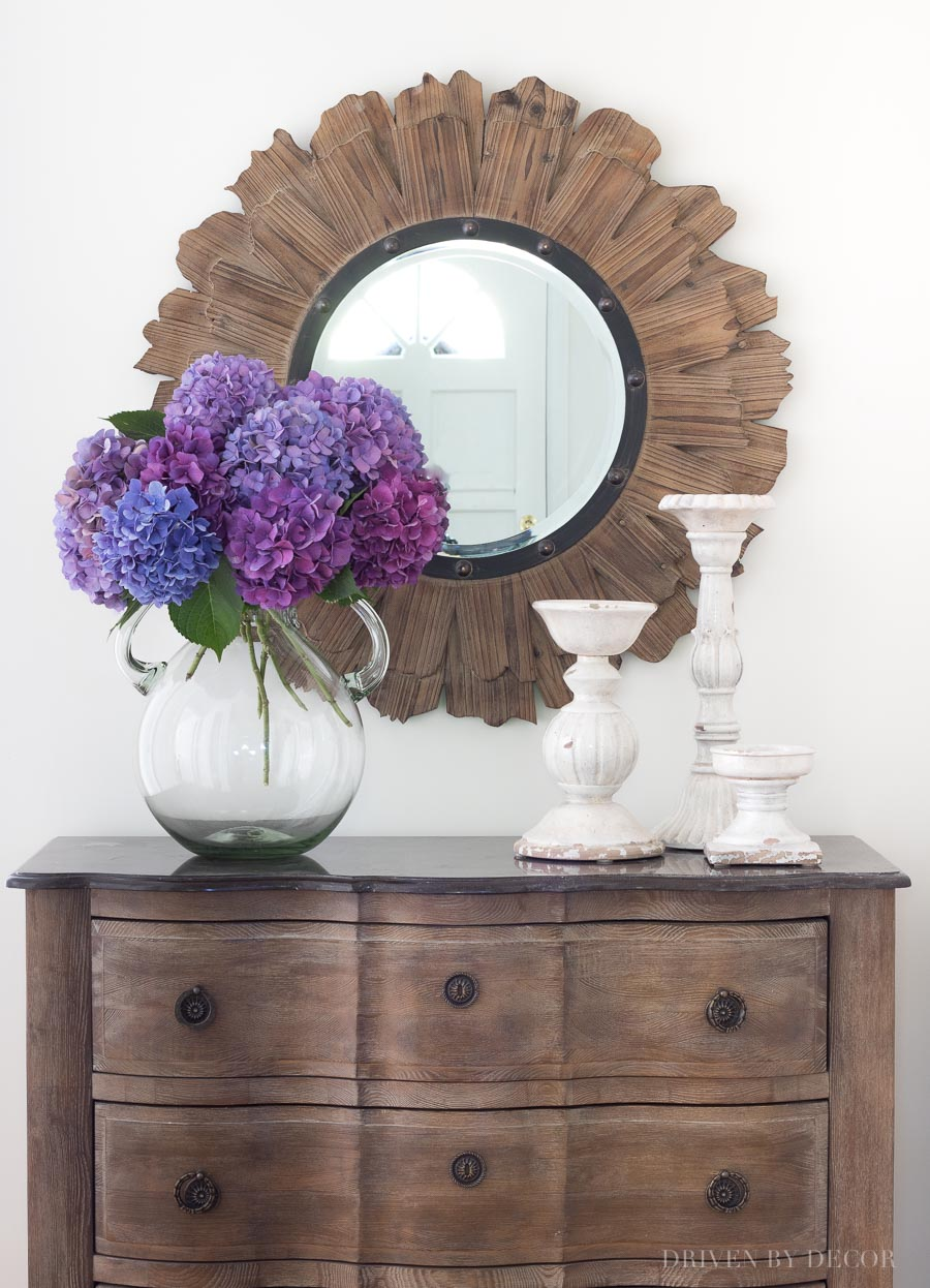 LOVE this round wood mirror! Links to this beauty and lots of other round mirrors in this post!