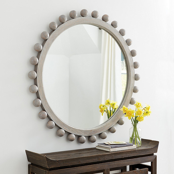 Statement-making round wood mirror - love the design and the graywash finish!