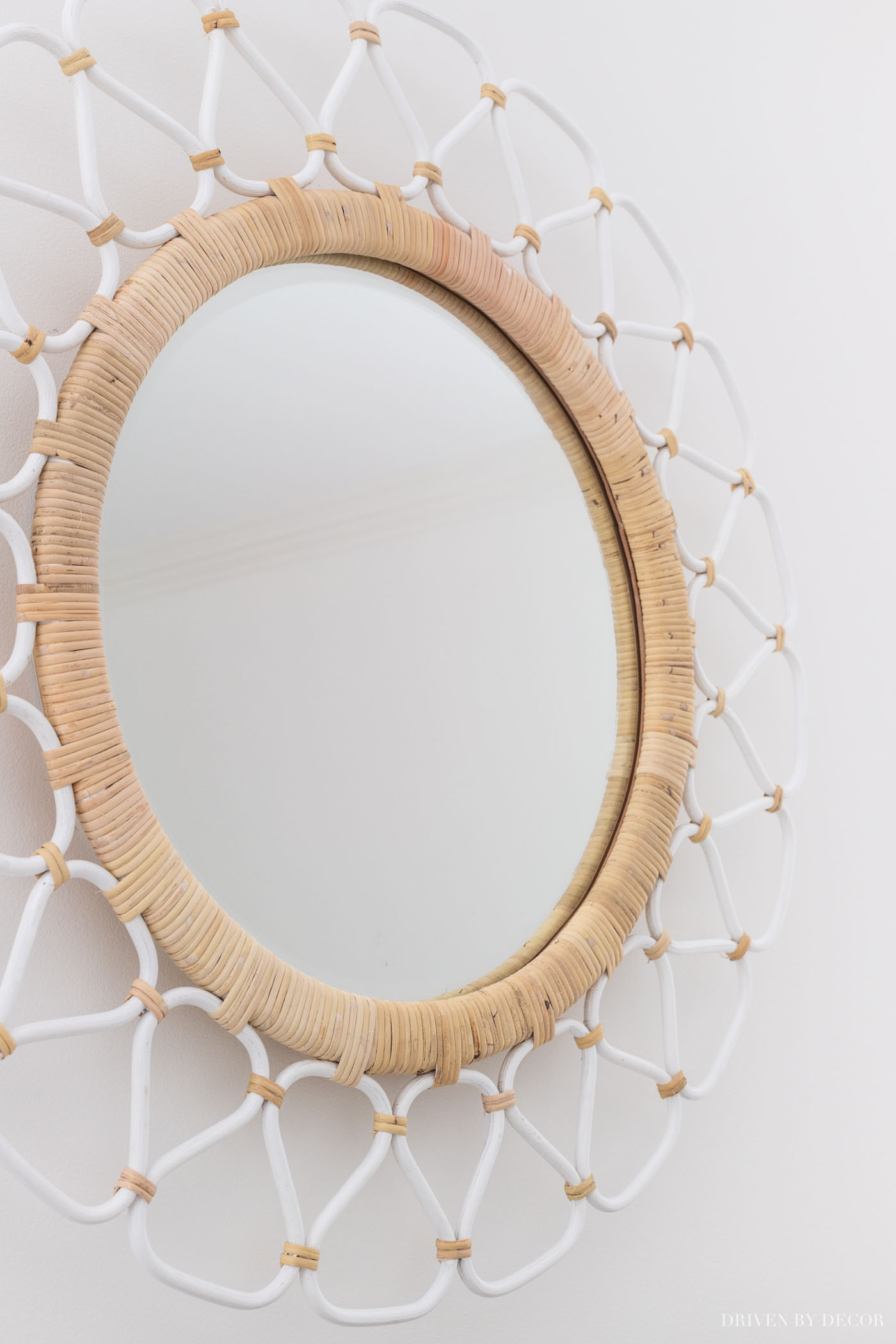 Love this rattan mirror that she put above the bed!