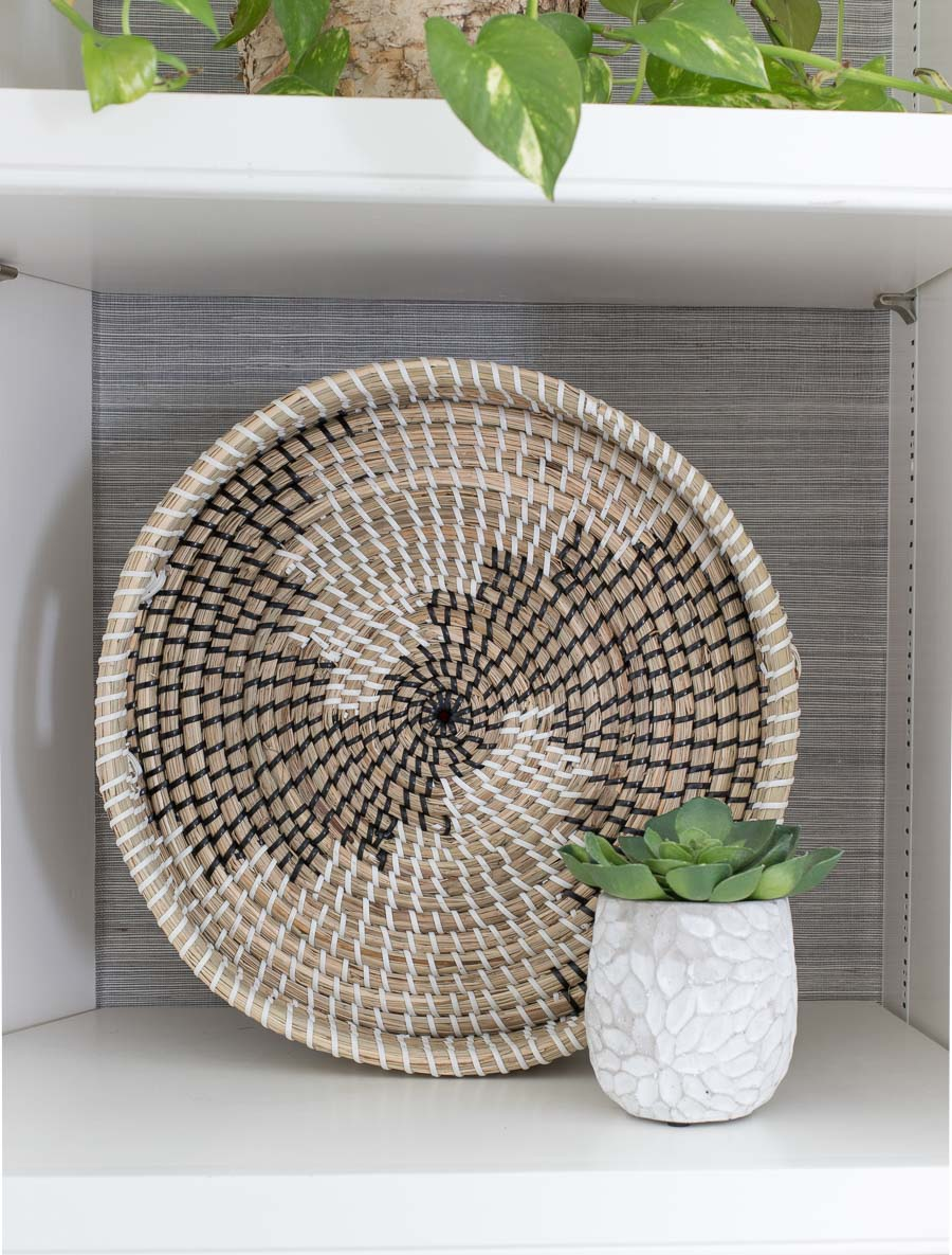 Round woven tray - love the look on the back of a bookcase!