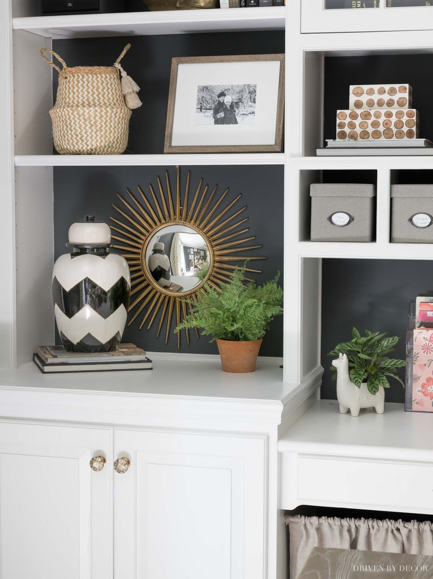 Love the starburst mirror she has on the back of her bookcase!