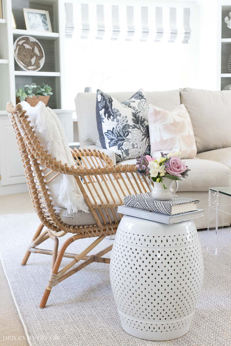 This white ceramic garden stool is one of my all-time best home purchases! Perfect for a side table in my living room and drink table on my patio!