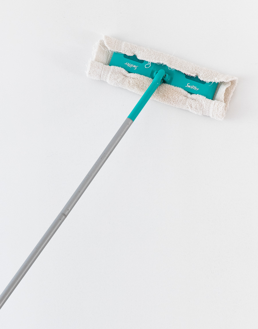 Such a smart tip for cleaning drywall dust before painting - with a Swiffer! Check out all of the other time-saving painting tips in this post!