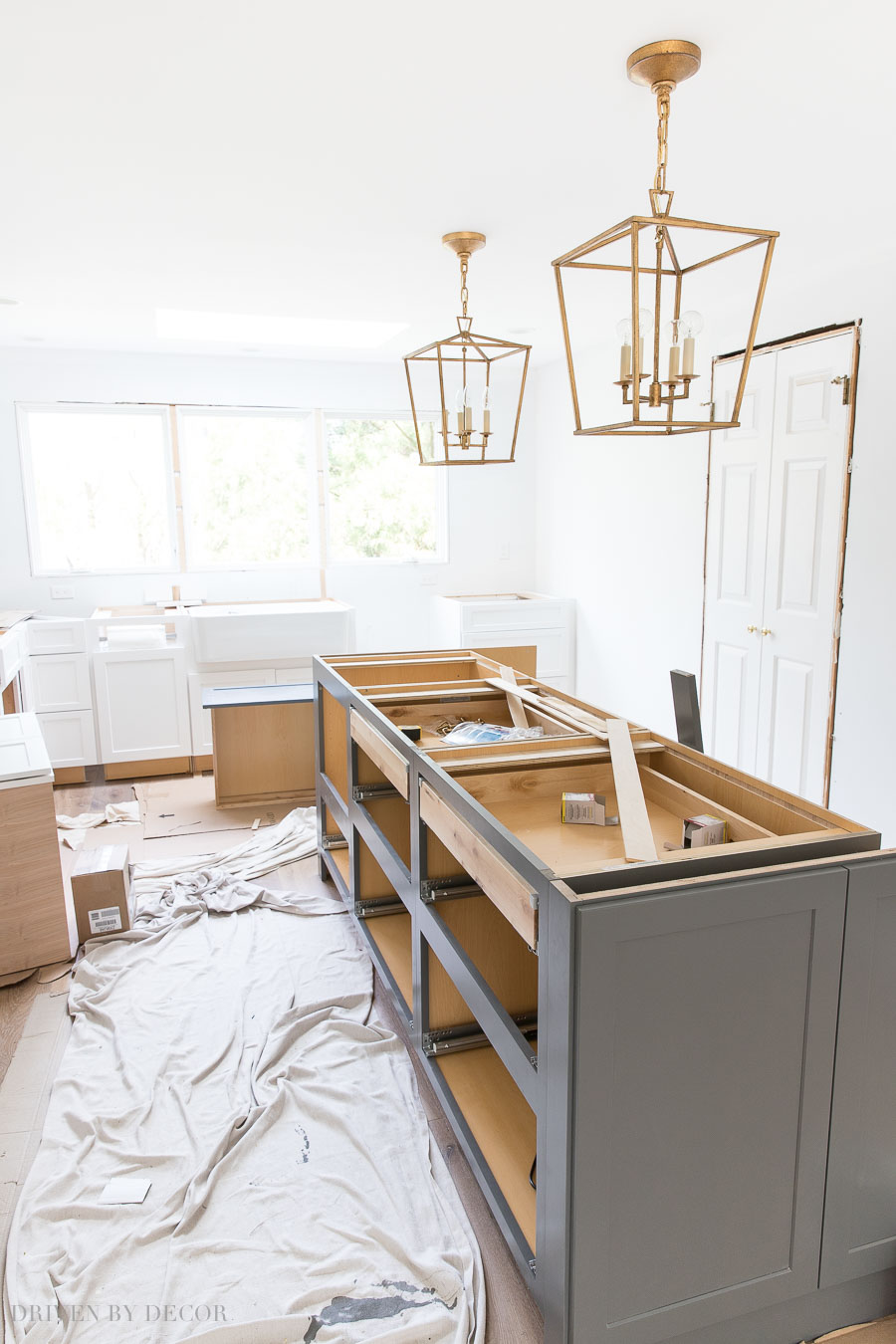 So fun seeing the progress on this kitchen remodel! Love the lighting and gray and white cabinets!