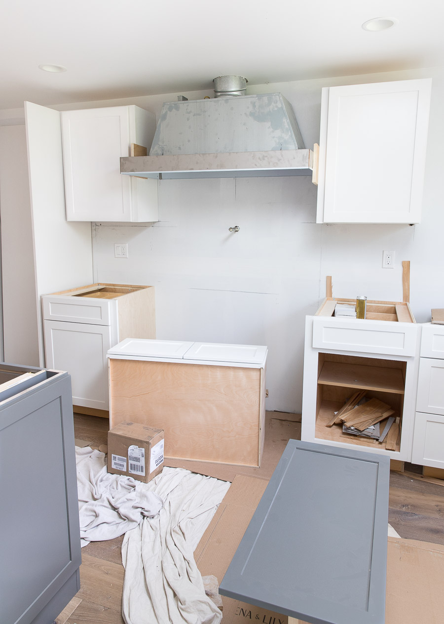 Loving seeing the behind the scenes of this kitchen renovation - range hood and cabinet installation!