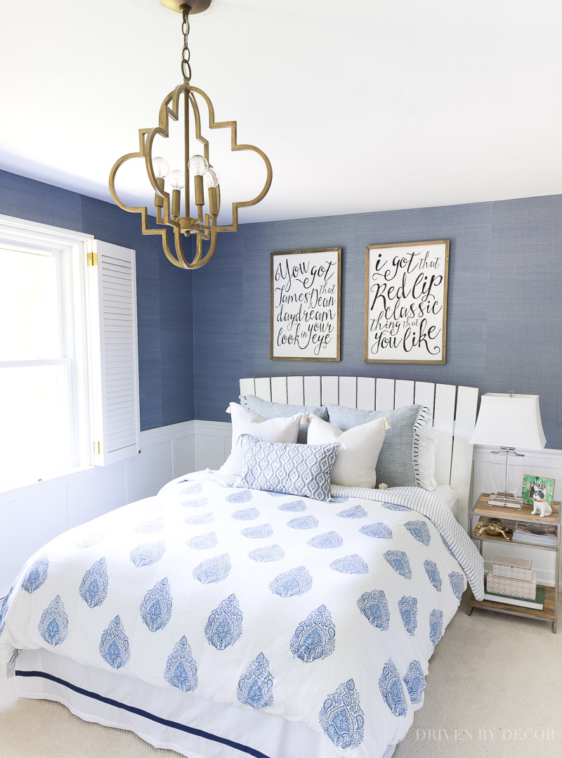 Loving this blue and white bedroom with block print bedding, grasscloth wallpaper, Taylor Swift wall art, and quatrefoil pendant lighting!