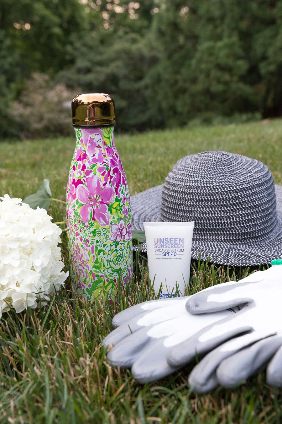 My gardening favorites - invisible sunscreen, floppy hat, gloves, and water bottle - I've linked the exact items in my post!