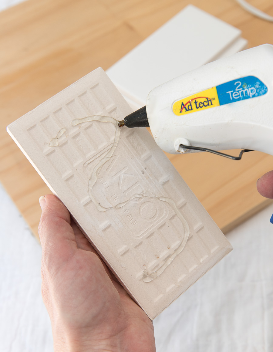 Add hot glue to the back of a tile to make a tile sample board - so helpful in choosing a grout color!
