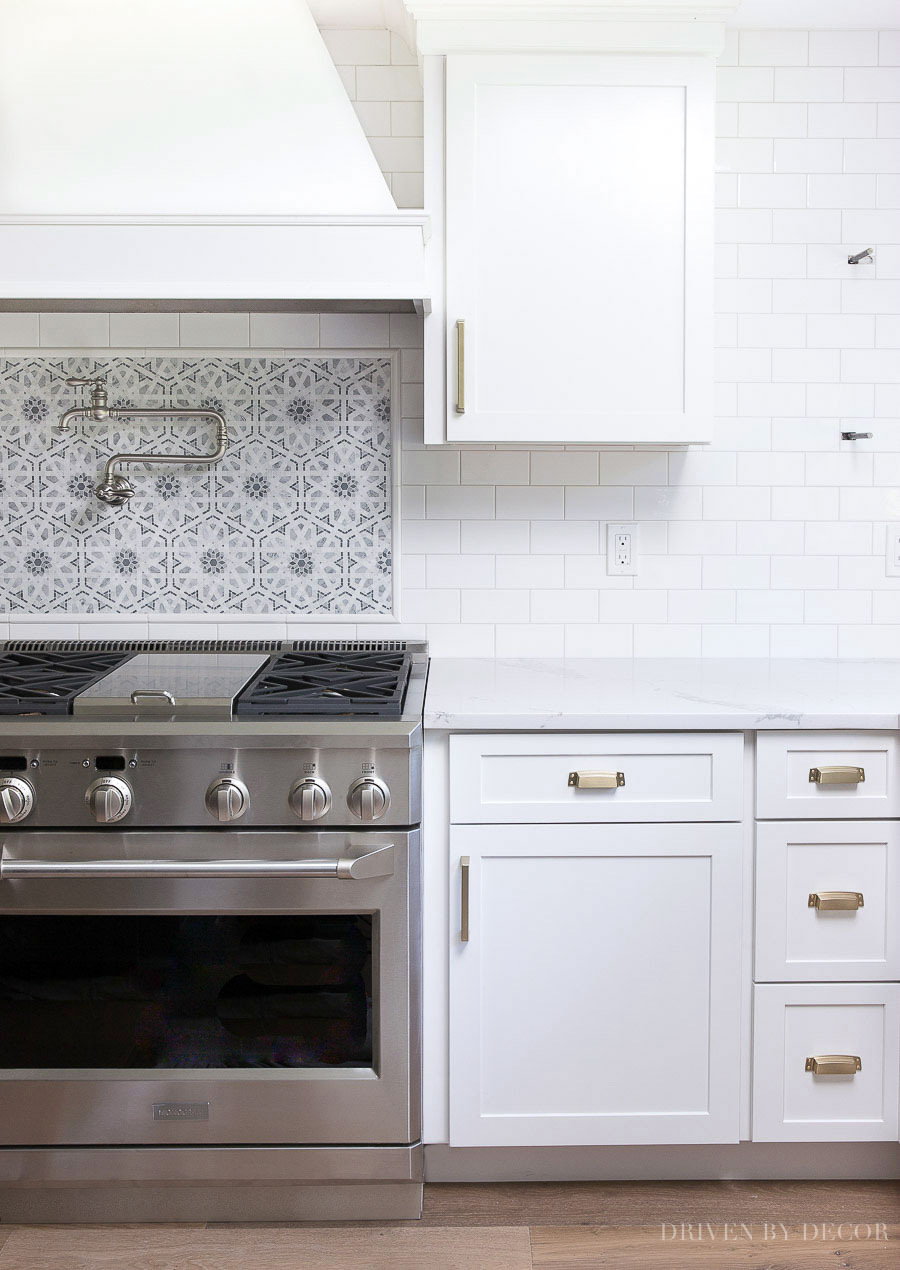 White subway tile with gray grout - light gray grout was perfect with this mosaic accent!