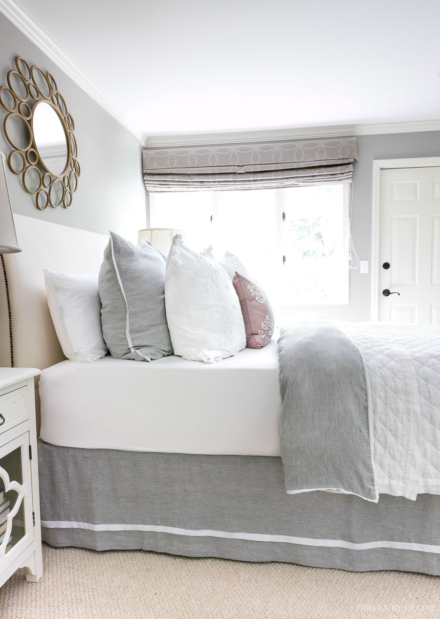 The perfect quilt, duvet, and bedskirt combination! Love the idea of using classic, neutral bedding pieces and switching things up with a simple change of pillows!