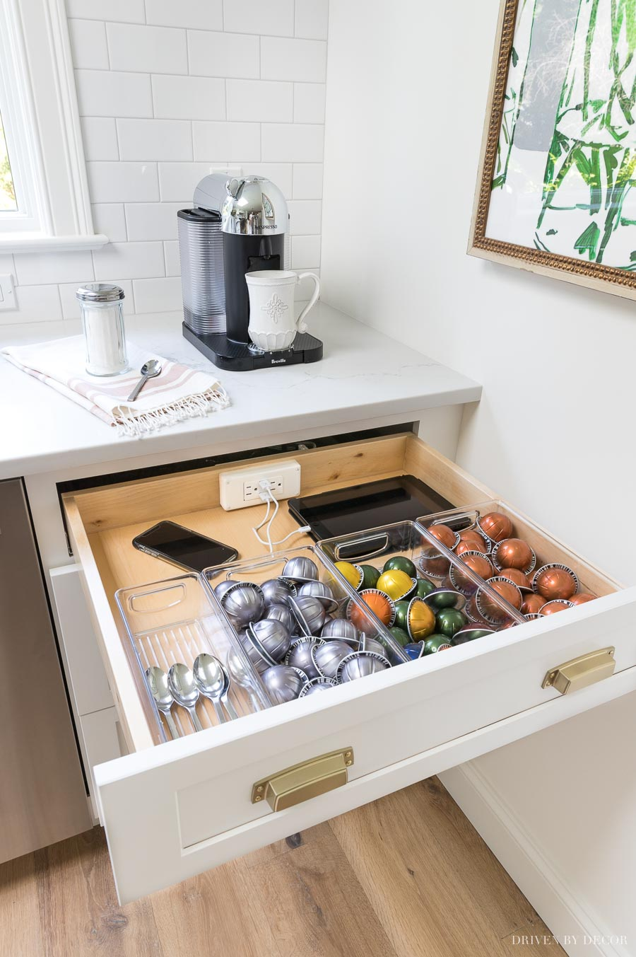 An outlet with USB ports is built into this kitchen drawer! Love having a hidden place to store electronics and plug in small kitchen appliances!