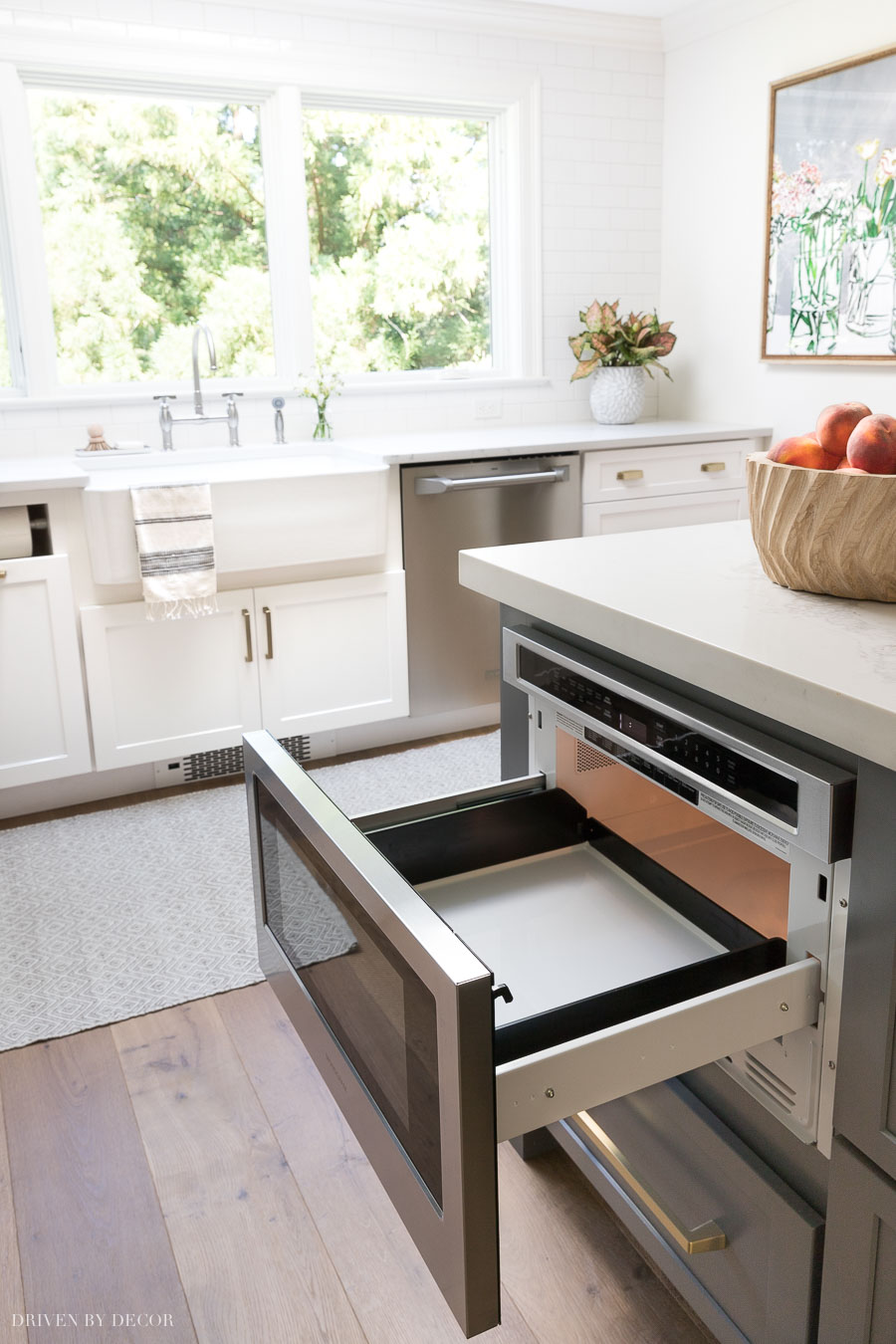 I wasn't sure if I would like having a microwave drawer in my kitchen island, but I LOVE it! More details about it in my kitchen remodel reveal!