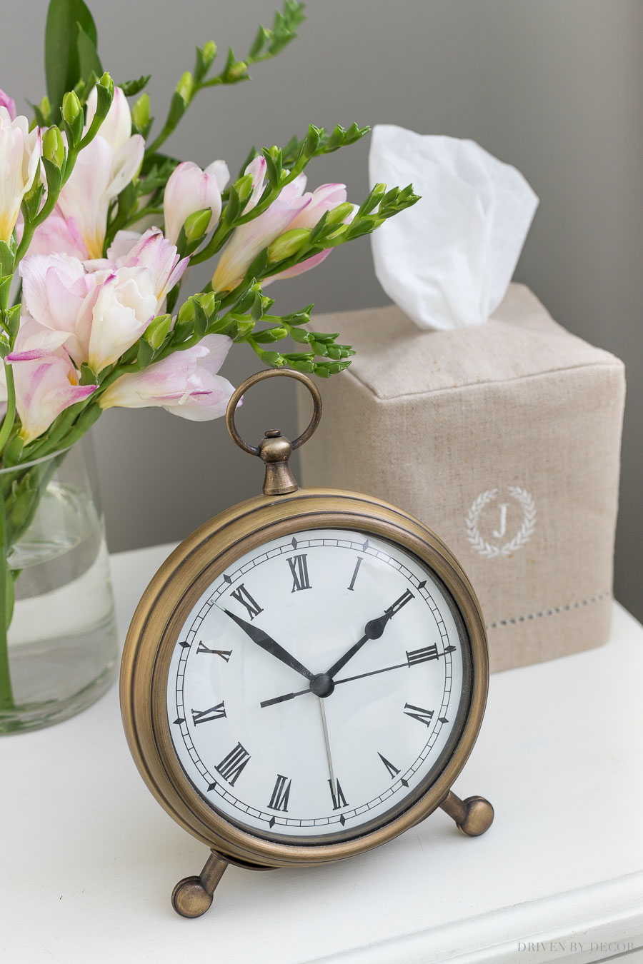 Must-haves for your guest bedroom nightstand - a clock (love this one!) and a box of tissues (love this pretty tissue box cover!)