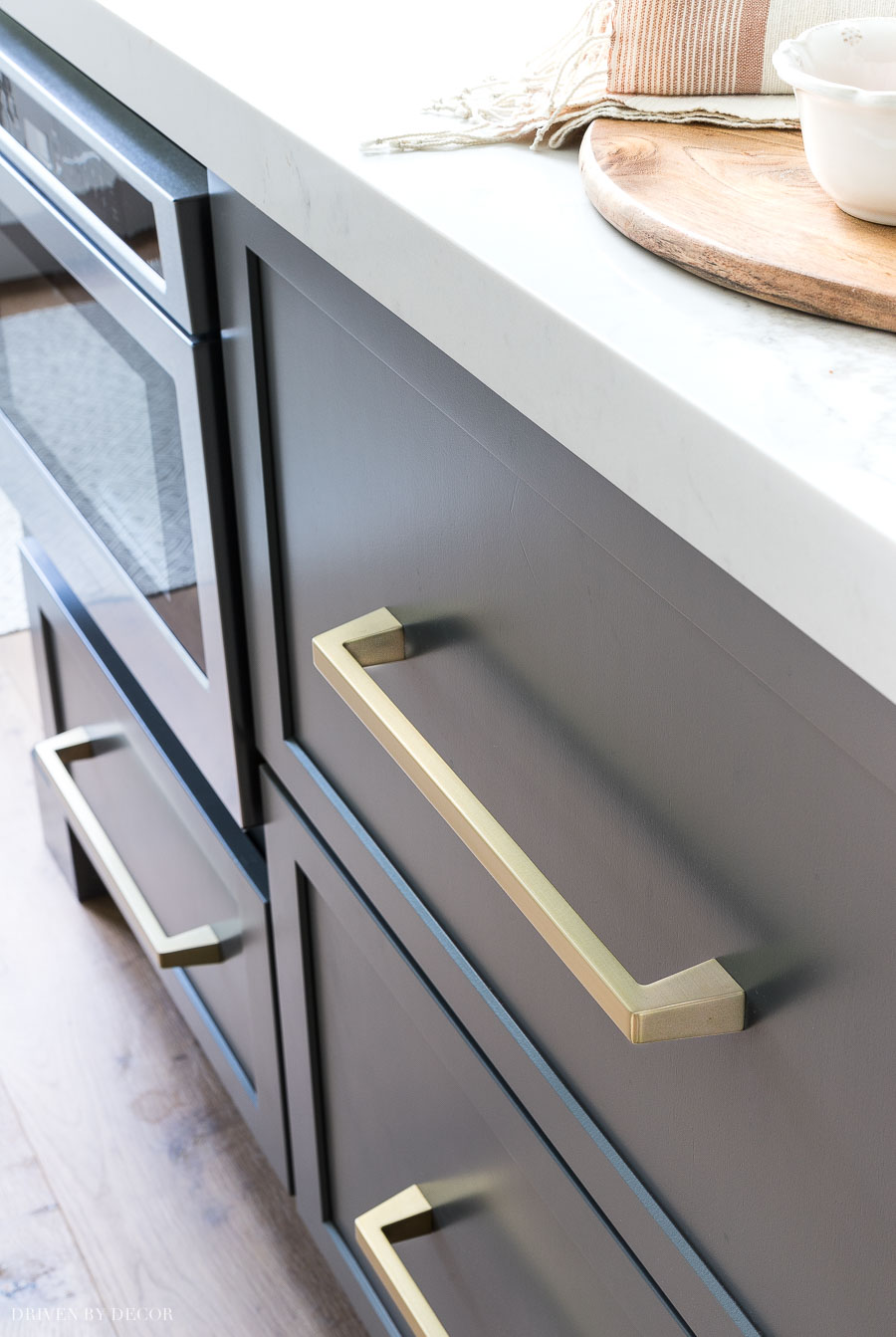 Beautiful soft brass pulls that look amazing on the gray cabinets (and on the white ones in this kitchen too!)
