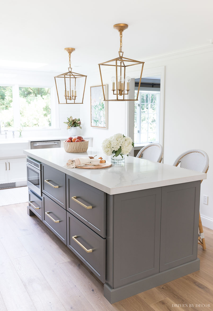 Loving all of the deep drawer space in this long kitchen island (and love the shade of gray!)
