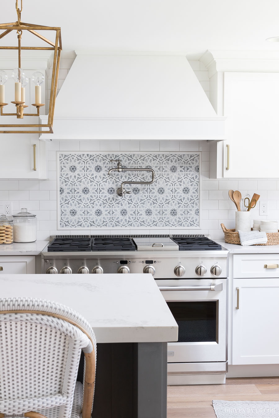 I am in LOVE with that mosaic tile accent behind the range! And that pot filler! All sources provided in the post!