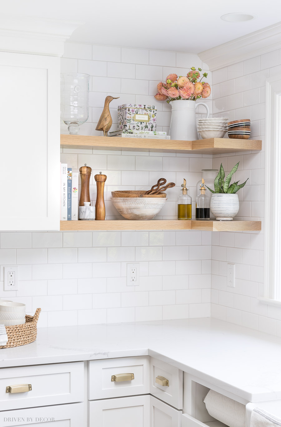Totally stealing ideas for what to put on my open kitchen shelving - love these accessories! Also how the shelves wrap around the corner!