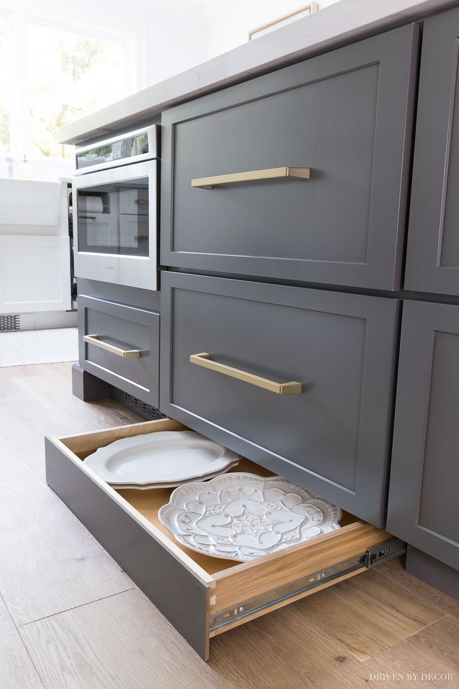 A push on the toekick with your foot reveals a hidden toekick drawer with shallow storage space for trays and other large, hard to store kitchen items!