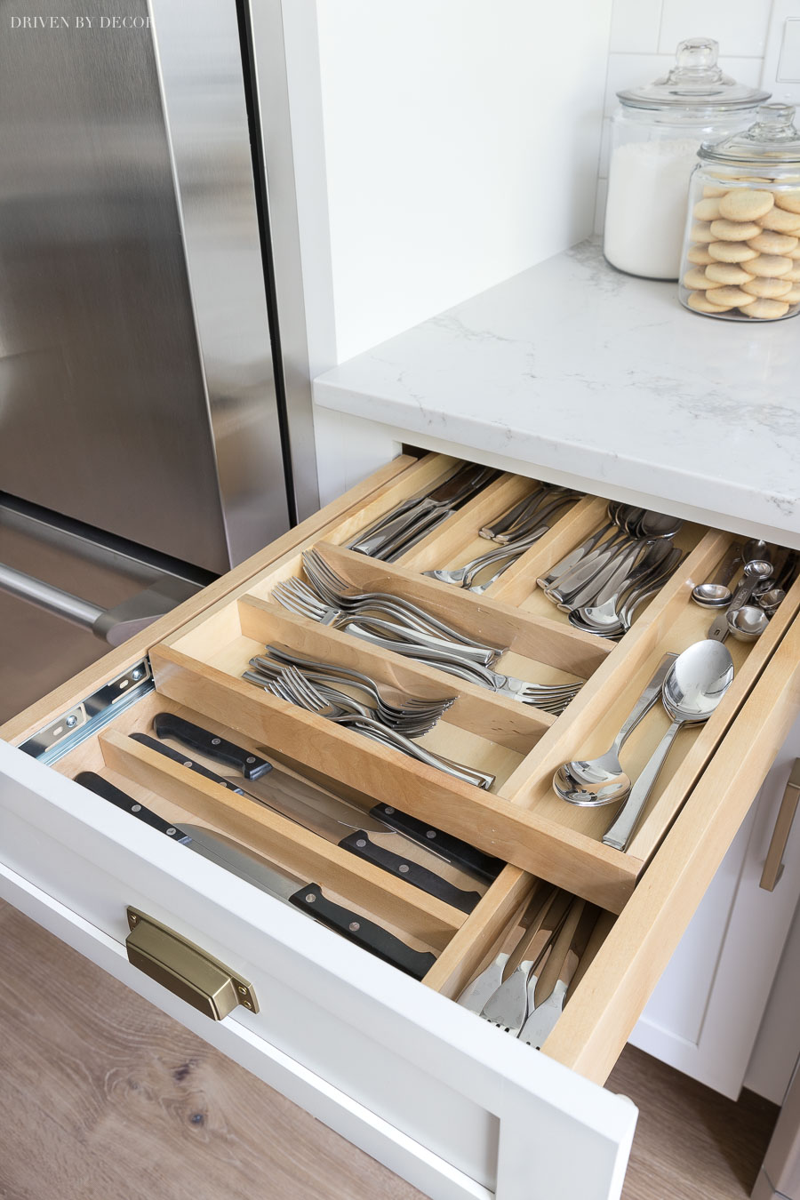 Two tiered divided cutlery drawer - put your most used silverware on the top and have room for steak knives and other less commonly used cutlery on the bottom!