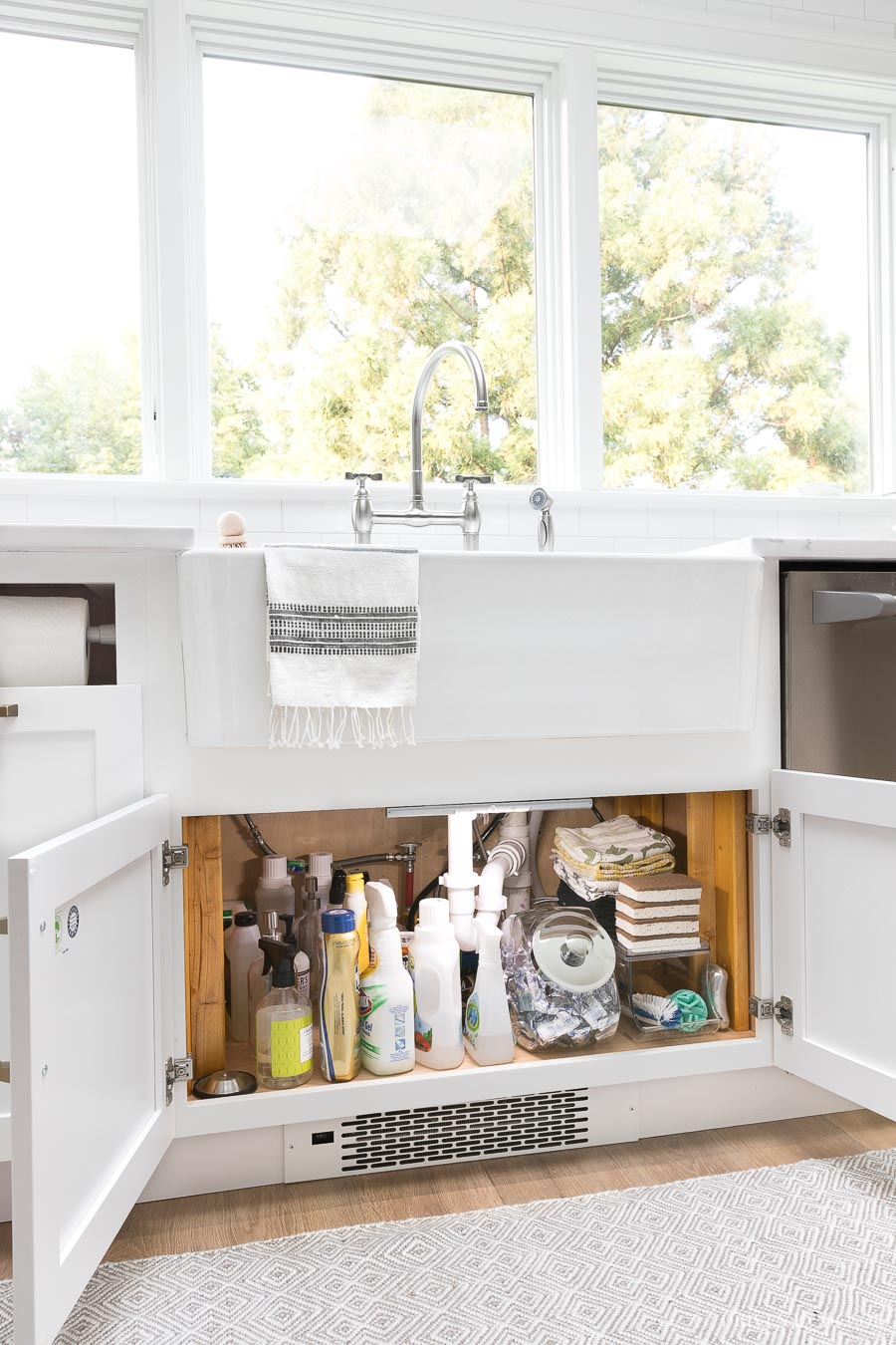 Love this idea for lighting up the inside of a cabinet! Install motion strip lighting so when the doors of the cabinet are opened, the battery-operated light illuminates what's inside! Perfect for under the sink!
