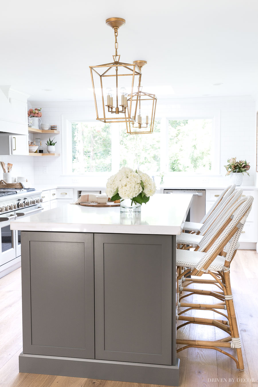 Love the color of this long, dark gray kitchen island with counter height seating!